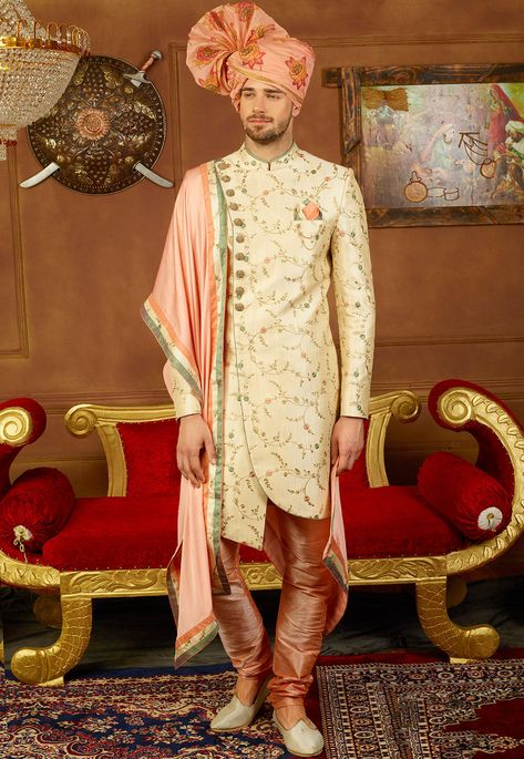 Art Silk Sherwani in Cream This Readymade attire with Satin Lining is Enhanced with Resham, Zari, Buttons and Pockets. Crafted in Chinese Collar and Full Sleeves Available with a Art Dupion Silk Churidar and Art Silk Dupatta in Peach Do note: Footwear shown in the image is for presentation purposes only. Half to one inch may vary in measurement. (Slight variation in actual color vs. image is possible).