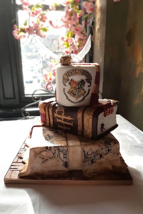 Fully handpainted featuring the Marauder's map, spell book and Hogwarts logo. Designed by Debbie Gillespie Cake Design, supplying unique and innovative cakes for creative couples Firefighter Grooms Cake, Camo Grooms Cake, Batman Grooms Cake, Alabama Grooms Cake, Grooms Cake Tables, Chocolate Grooms Cake, Groom Cake, Harry Potter Desserts, Gateau Harry Potter