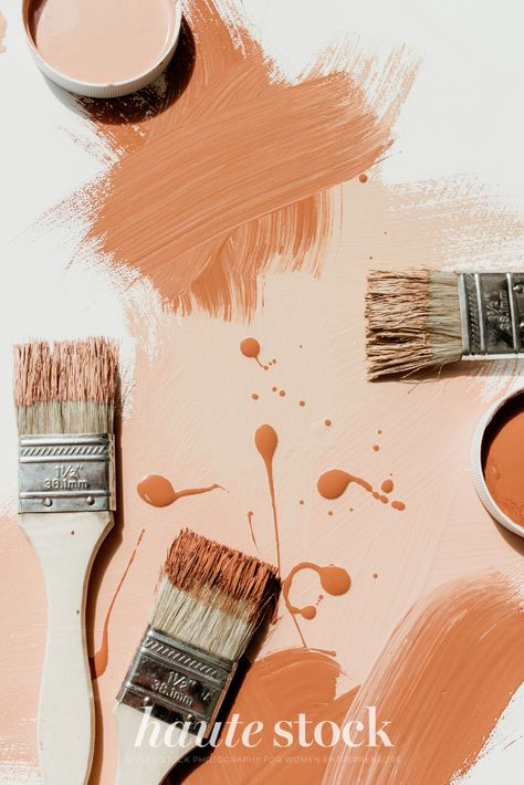 Pink & orange artsy and creaitve styled stock photography for female entrepreneurs featuring orange paint and paintbrushes flatlay. #hautestock #workspace #stockphotography #styledstockphotography #femaleentrepreneur #blogger #socialmedia #graphicdesign #creative #workfromhome