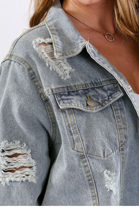 Super trendy and perfect for layering over your favorite tank, this slightly distressed jacket is perfect for your wardrobe all year round. 100% Cotton Hand wash cold, do not bleach, lay flat to dry Measures 24.5 from shoulder to hem on size small Size small is pictured Imported #denimjacket #90sstyle #2000sfashion #distressedjacket #grungestyle
