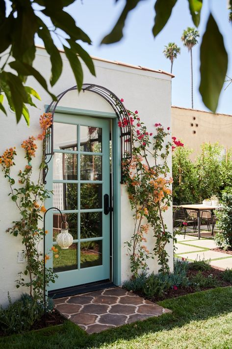Before & After: A Dilapidated Spanish Revival Home in L. Gets a Dazzling Renovation - A new arched doorway framed by a delicate flower trellis creates a lush, storybook vignette. Spanish Revival Home, Spanish Style Homes, Spanish House, Spanish Hacienda Homes, Spanish Patio, Spanish Style Interiors, Spanish Exterior, Spanish Colonial, Bungalows