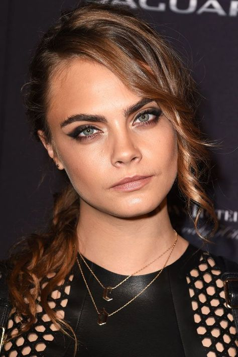 Cara Delevingne isn't afraid of changing up her look and her beauty evolution proves it. And, nope, her purple hair isn't even her wildest look.
