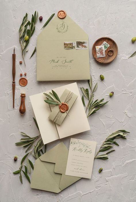 Sage green invitations with copper seal.
