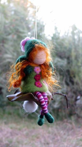 MADE TO ORDER  I just love to combine wool with nature. These little fairies ornaments are my favorite creations. Each of them has its own personality, there can not be two the same.  This little Christmas fairy ( the fairy is about 13 cm, 5.5) is sitting on a seed, holding stars. A little addition of magic. I love to give them as presents for my friends and their children. They are needle felted, Waldorf inspired dolls. Felt ornament  You are welcome to my shop to see more of my fairies and ...