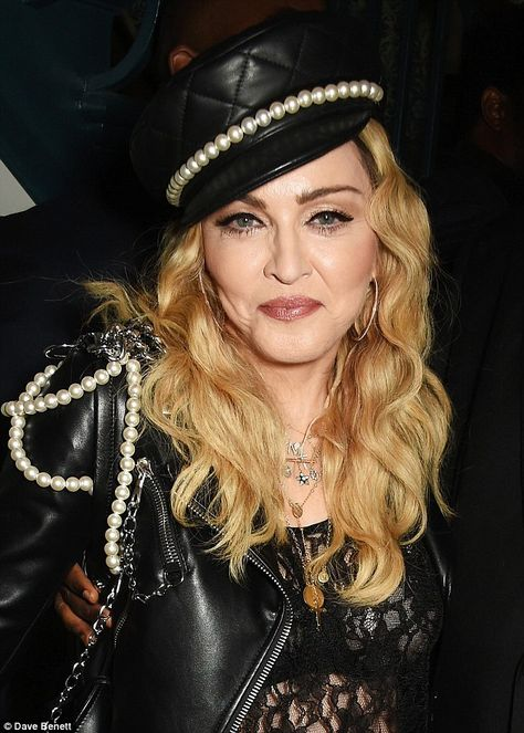 Doormen, however, turned a blind eye to Madonna's transparent netted top, ripped jeans and leather jacket