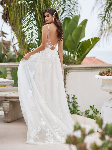 For the carefree bride that wants to feel as light as a feather on her special day, style Laguna from Simply Val Stefani will make all her wildest dreams come true. Beaded thin straps support the deep illusion v-back with cutout at the back waist. Romantic lace appliques are decorated along the gown while a soft net skirt flows down into a sweep train finish. #alineweddingdress #laceweddingdress #bohoweddingdress #beachbride