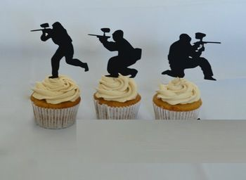 paintball silhouettes on cupcakes instead of cake