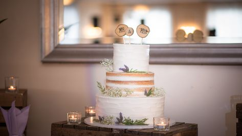 This beautiful wedding cake at Valleybrook Country Club is the perfect inspo for your Spring/Summer wedding! #ValleybrookCountryClub #RonJaworskiWeddings #NJWeddings #PAWeddings #NJWeddingVenue #PAWeddingVenue #WeddingCake #Cake #Spring #Summer #Flowers #Candles #Intimate #WeddingInspo