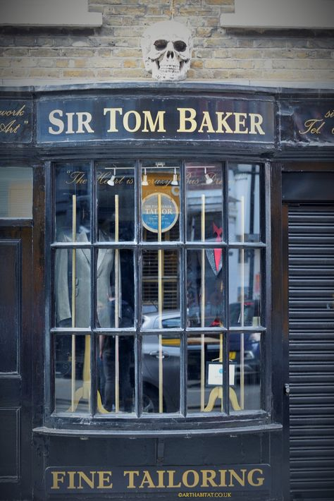 afbdfd6efabe4 Amazing old fashioned shop window of Sir Tom Baker Bespoke Tailoring at  Soho. Tom Baker works strictly in the traditional British bespoke manner.