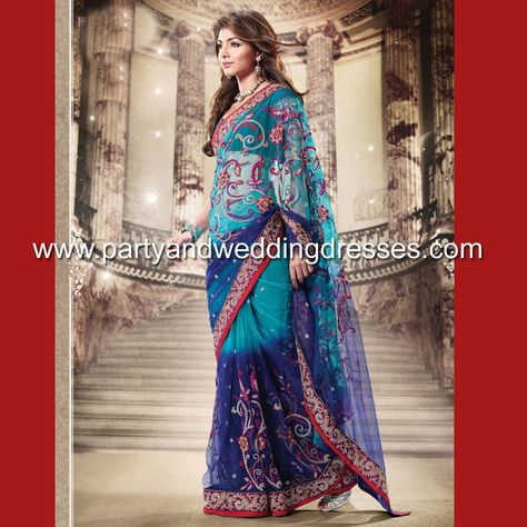 This saree is incredible! The shades of blue, the red and gold embroidery, what's not to love?