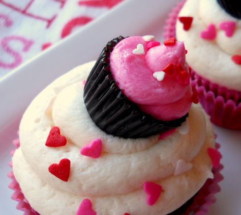 Decorating Cupcakes...With Cupcakes?! - use mini peanut butter cups to make a cupcake topper!