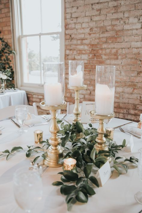 Candle wedding centerpiece: Timeless Greenery and Gold Wedding at The Filter Building Round Table Centerpieces, Gold Wedding Centerpieces, Greenery Centerpiece, Wedding Table Centerpieces, Green Centerpieces, Greenery Decor, Wedding Reception Table Decorations, Graduation Centerpiece, Floral Wedding Decorations