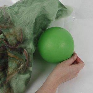 Decorative woollen pots felted over a balloon.