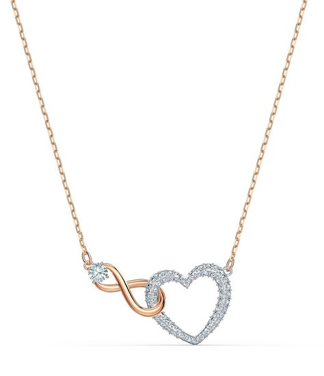 """Eternal romance: The symbols of love and infinity are bound together in this elegant Swarovski necklace. A white crystal heart is intertwined with a rose-gold tone plated infinity symbol in this lovely piece, which is a visible representation of the promise of everlasting love.Mixed metal finish/crystalLobster Clasp ClosureTwo Tone/CrystalApprox. 14.875"""" x 0.5"""" x 0.875""""Imported."""
