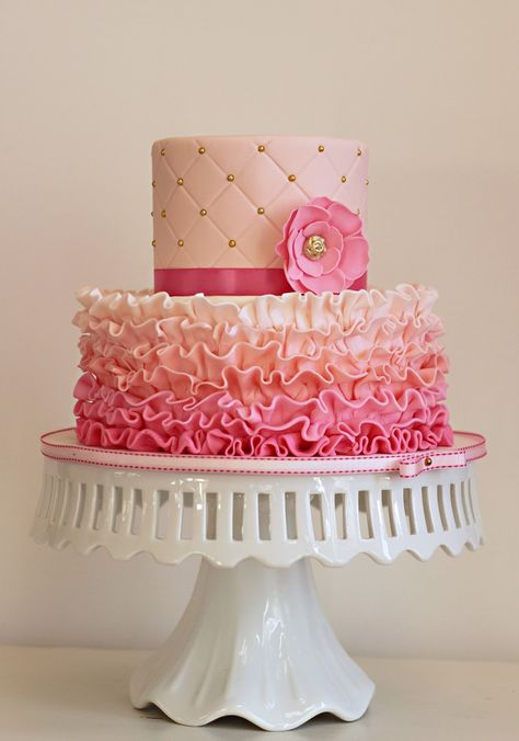 Two of the hottest trends in wedding design right now are ruffles and ombre. This unique cake showcases both trends beautifully!