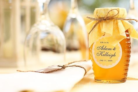 love the idea of honey for a wedding party favor, but prolly put it in a glass jar instead