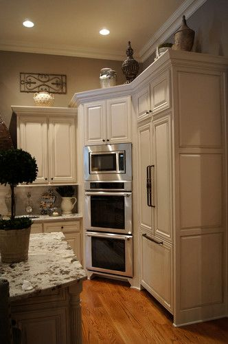 Kitchen: double oven with microwave installed above it in the wall