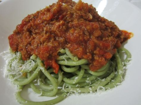 Homemade spinach pasta topped with hearty meat sauce.