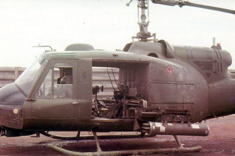 USMC UH-1E helicopter gunship sits ready on tarmac at Basecamp 68-69