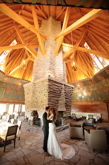Our spectacular lodge was designed in 1923 by the world-renowned architect Frank Lloyd Wright and built in 2001. The Wigwam Room is the heart of the Clubhouse and provides an unparalleled setting for an indoor reception. #DiscoverNakoma #LiveElevated #NakomaResort #NakomaWedding #WeddingVenue #DestinationWedding