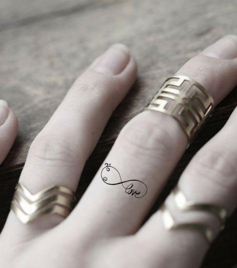 1001 Idee Per Tattoo Infinito Simbolo Dell Eternita Tatuaggi Per Le Donne Tatuaggi Sulle Dita Anelli Tatuaggio