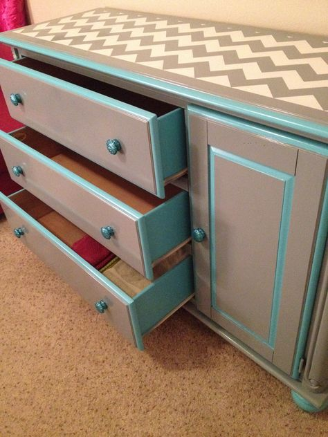 Chevron Dresser Makeover - sides of drawers painted teal, knobs done with Mod Podge & glitter, grey was spray paint, white & teal were oil paint.