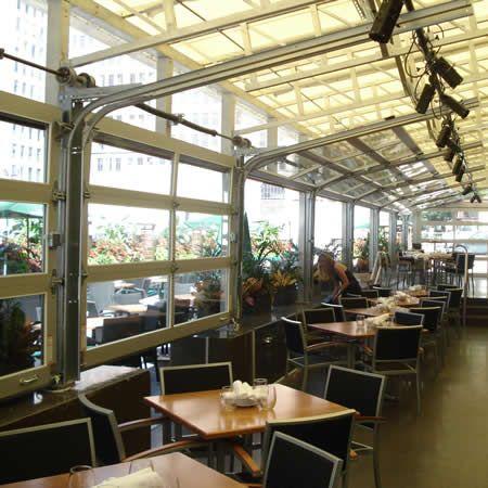 aluminum full view glass garage doors on restaurant Commercial