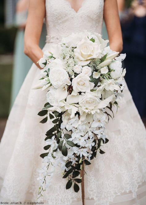 You can't go wrong with a classic white wedding bouquet. Depending on which stems you choose, a white bouquet can achieve any type of sty. Hand Bouquet Wedding, Rose Bridal Bouquet, Bridal Flowers, Orchid Bridal Bouquets, Flowers For Weddings, Cascading Wedding Bouquets, Wedding Flower Arrangements, Floral Wedding, White Bouquets