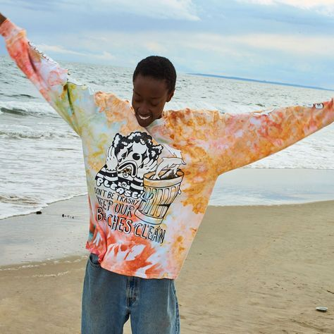 In honor of preserving the ocean and beaches that are so beloved to us here in Rockaway, we are donating 30% of the profits from the sales of this t-shirt to Surfrider NYC, a foundation dedicated to the protection of the ocean, waves, and beaches that we love and enjoy. Tie-dye ranges from deep gold, to bright coral, teals and greens. Each is unique and coloration will vary shirt to shirt. Artwork by us, hand-dyed in Brooklyn, screen-printed in Queens. Small batch, limited run. Size Chart &