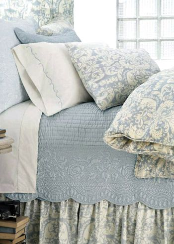 Gianna Dusty Blue duvet by Pine Cone Hill is shown here with the coordinating Gianna dusty blue bed skirt and sham, Fanny dusty blue quilt and embroidered hem ivory/dusty blue sheeting.
