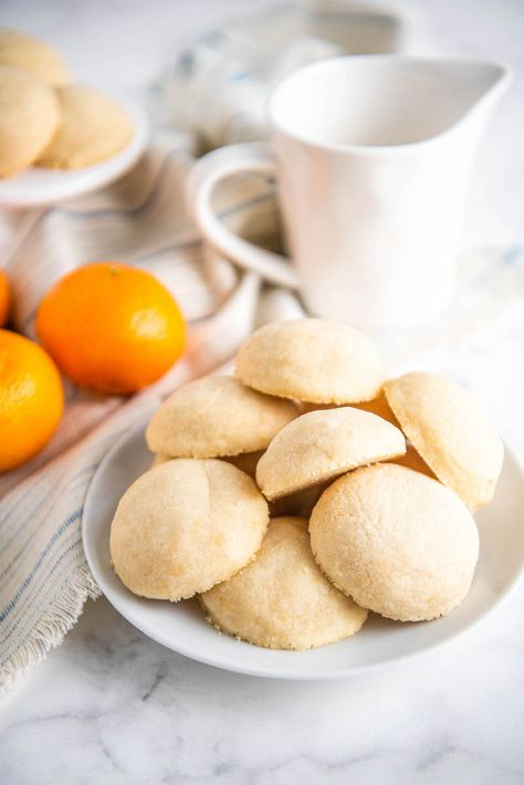 These Orange Whipped Shortbread Cookies are crumbly, buttery, melt in your mouth shortbread cookies with a surprise lightness from added orange zest! #shortbread #ShortbreadCookies #ShorbreadCookieRecipe #Shortbreadrecipe #WhippedShortbreadCookies #Dessert #ChristmasCookies #CookieRecipes #Orange #OrangeCookies