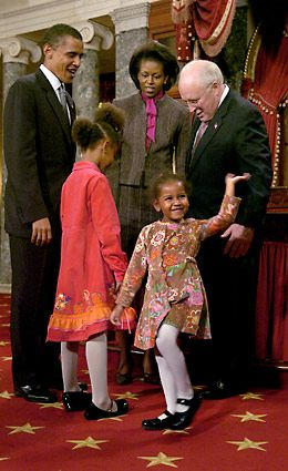 Vice President Dick Cheney watches as Sasha Obama, 3, waves to cameras during a mock swearing-in for her father, Sen. Barack Obama, at the U.S Capitol.
