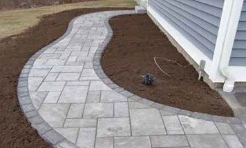 Techo Bloc Blu Shale Grey Curved Walkway With An Onyx Black Border Patio Stones Paver Patio Bluestone Walkway