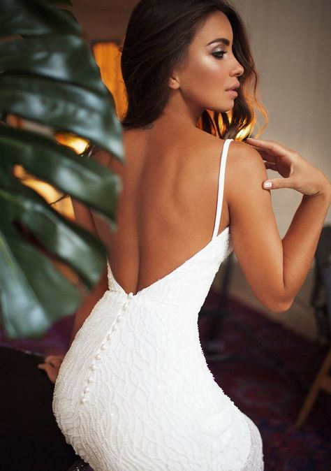 Reception/ rehearsal dinner dress for bride with detachable train If you like idea of showing your legs - this dress is a perfect for it , The dress is made from fully beaded lace . The lining could be made floor length and has any color you prefer. On pictures all dress is made in light ivory