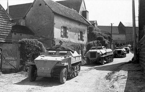 "German Halftrack leading a column of Panzerwerfer 42 ""Maultier"", Summer 1944."
