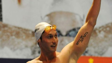 Fabien Gilot, a member of the gold medal-winning 4 x 100 team raised his arm in triumph to reveal a tattoo in Hebrew reading: אני כלום בלעדיהם - in English: I am nothing without them.    It is a tribute to his grandmother's Jewish husband, Max Goldschmidt, an Auschwitz survivor.