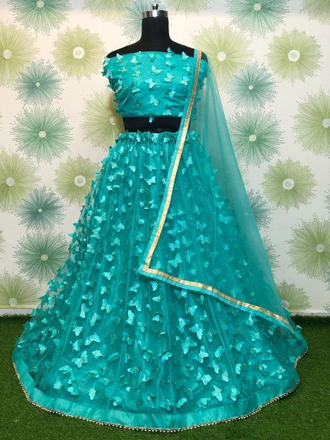 """""""Buy an Exclusive Heavy Mono Net Lehenga Choli With 3D Butterfly Embroidery Work, Latest Trendy Ethnic Lehenga Choli. *Lehenga : Heavy Mono Net* *Work: 3D Butterfly Embroidery and Motti Border* *Inner: Inner Silk* *Flair : 3 MTR * *Blouse Fabric : Heavy Mono Net* *Work: 3D Butterfly Embroidery* *Size: 0.90 MTR* *Blouse Inner : Yes* *Duppta Febric : Heavy Net* *Size: 2.15 MTR* *Weight: 600 GM* What is {Semi stitched=>Semi-stitched Semi-stitched lehenga means that the pattern of the lehenga is"""