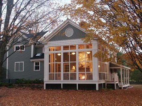 Screened in porch with fireplace.