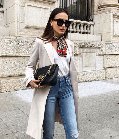 jeans and a white tee with a trench and scarf