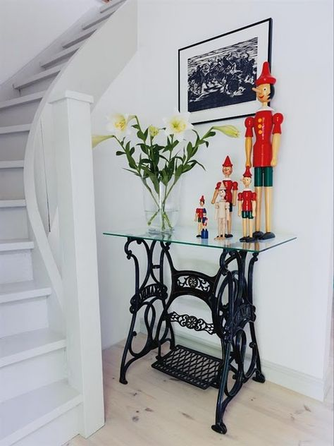 Great re-purpose of an old, beautiful sewing machine stand.
