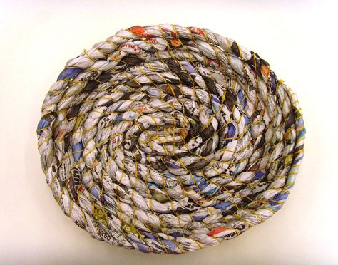 A coiled basket made by our artist-in-residence Stella Harding from copies of 'City AM' magzine.  http://www.cityoflondon.gov.uk/things-to-do/visiting-the-city/archives-and-city-history/guildhall-library/Pages/exhibitions.aspx