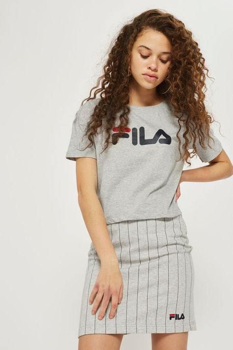 Retro sportswear is having a moment. Tap into the trend in our FILA logo tee. It's cut to a cropped shape for a flattering fit. We're wearing ours with a mini skirt and sneakers.