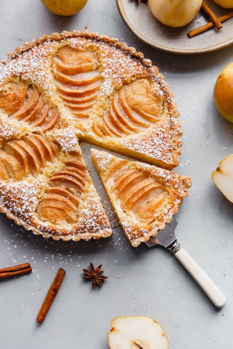 Pear Frangipane Tart - this classic French poached pear tart recipe is made with a sweet tart dough and filled with poached pears and frangipane (almond cream). This tart is delicious and is wonderful served on Thanksgiving or over the holiday season! Pear And Almond Tart, French Pear Tart Recipe, Pear Tart Recipe Easy, French Tart, Poached Pears Recipe Easy, Sweet Tart Dough Recipe, Galette Des Rois Recipe, Desserts Français, Lemon Desserts