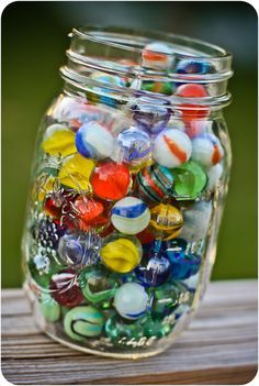 Marbles I Used To Have A Jar Full Of Marbles That My Grand Daddy Would Bring Me That He Found Out In His Garden Marble Art Marble Glass Marbles