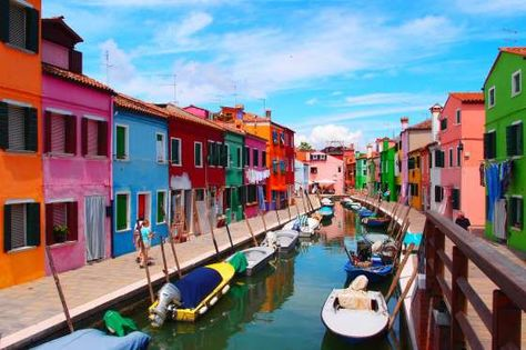 BURANO ISLAND, ITALY Only 3,000 people live on this island, which is located just off the Venetian Lagoon. Ancient legend says that fishermen were the first to paint their houses in the rainbow of colors we see today. According to folklore, the bright hues allowed them to see their homes from long distances while out fishing.
