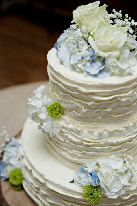White Wedding Cake with Blue Flowers