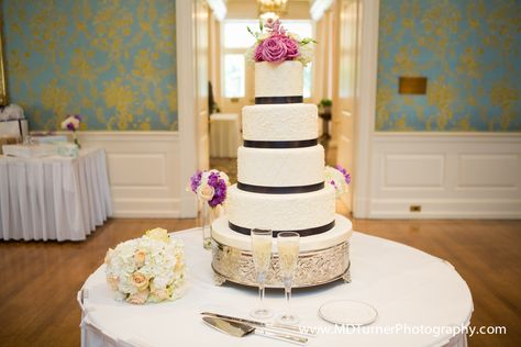 Tall white wedding cake with ribbon detail and floral topper - Houston wedding photography - MD Turner Photography