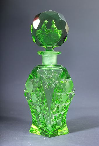 green glass perfume bottle with stopper