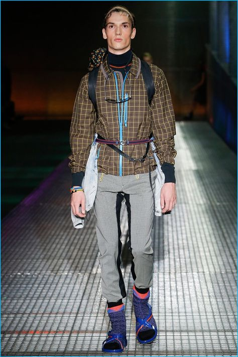 Approaching spring-summer 2017, Prada looked to the future with a sporty angle. Soft silhouettes encompassed the season as Miuccia Prada showcased voluminous parkas, colorful windbreakers and joggers. Accessorized with backpacks and strap sandals, models took to the metal grate runway, expanding on the Italian fashion house's global trek for the season. Checks and intricate prints...[ReadMore]