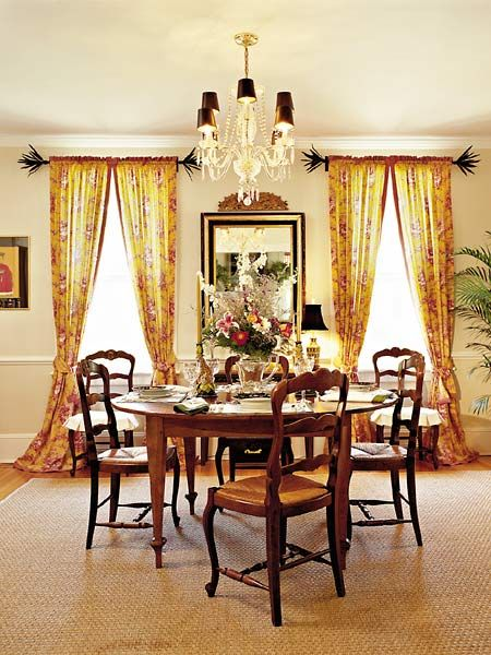 With A Neutral Foundation Of Creamy Walls And Sea Grass Rug Mustard Yellow Red Toile Draperies Offer Punch Color In This Dining Room